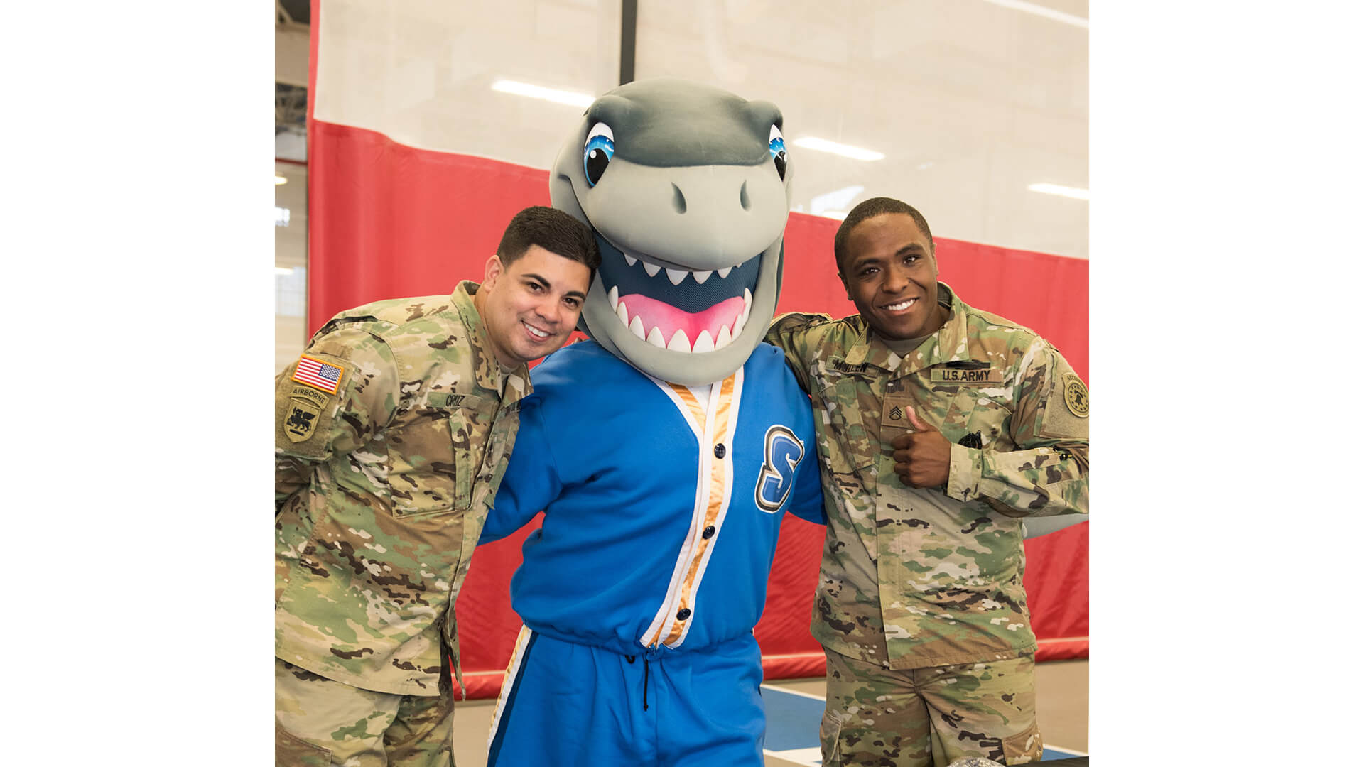 Photo of two active veterans and Finn the shark.