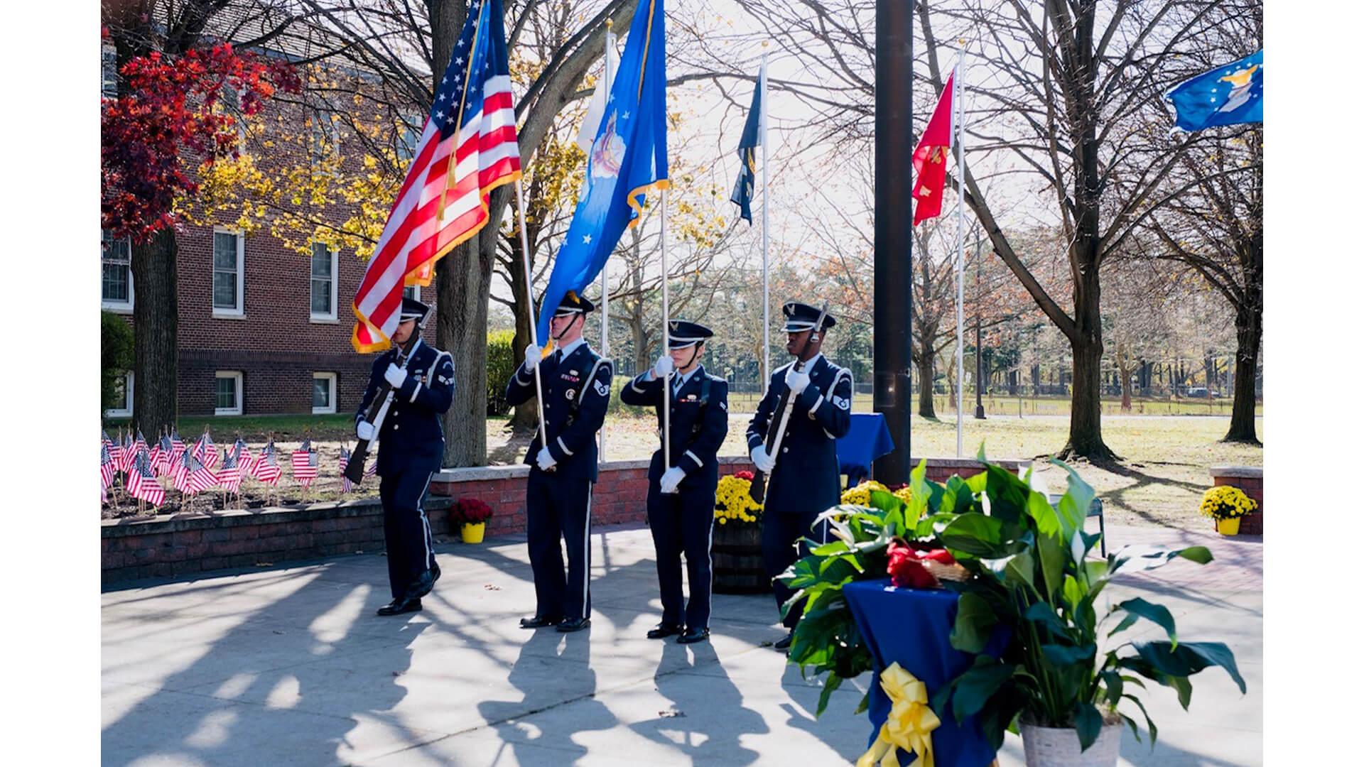 Veteran's holding the flag.