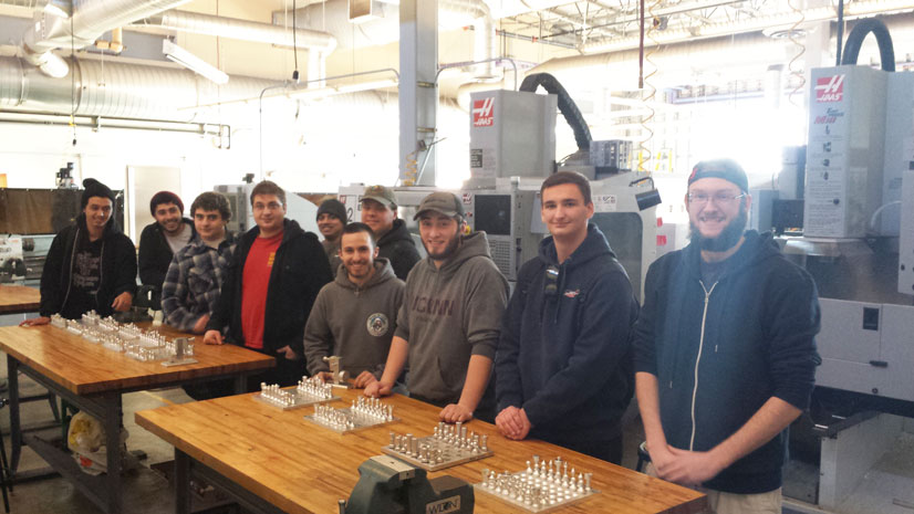 Students with chess sets designed in advanced manufacturing