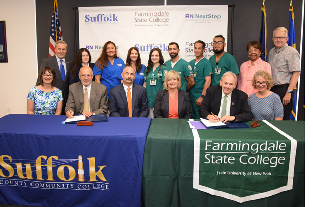 Nursing students, college officials and legislators cheered as The RN NextStep Joint Agreement between Suffolk County Community College and Farmingdale State College was signed.This important agreement provides a convenient and affordable upward mobility path for nursing students graduating with an Associate in Science (AS) degree in nursing from Suffolk County Community College.  Students admitted to Suffolk's AS in nursing program are guaranteed admission into the FSC Online RN to BS Completion Program, provided they have completed their AS degree at Suffolk and pass their boards to become licensed Registered Nurses.